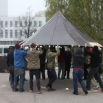 people lifting a hexayurt toof